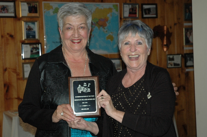 2016 Barbershopper of the Year recipient Bernice Blake- Dibblee ( on left) is presented with her award by Margie Fife, last year's recipient.