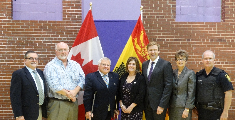 From left: Child and Youth Advocate Norman J. Bossé; Robert Fowler, DEC chair of Anglophone South School District; Service New Brunswick Minster Ed Doherty, who is also minister responsible for the Economic and Social Inclusion Corporation; Christine Roy, principal, St. John the Baptist / King Edward School; Premier Brian Gallant; Zoë Watson, superintendent of the Anglophone South School District and Sergeant David Hartley-Brown, Saint John Police.