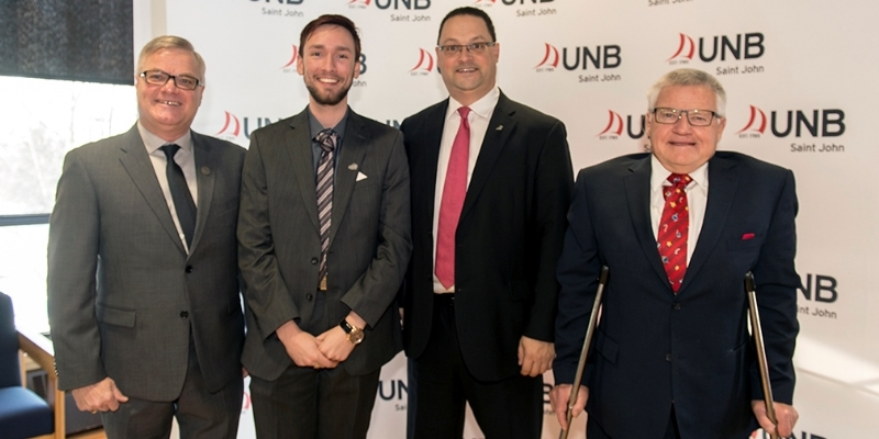 From left: UNB Saint John vice-president Robert MacKinnon; former Promise Partnership ‎participant Kyle Rogers; Post-Secondary Education, Training and Labour Minister Donald Arseneault; and Service New Brunswick Minister Ed Doherty.